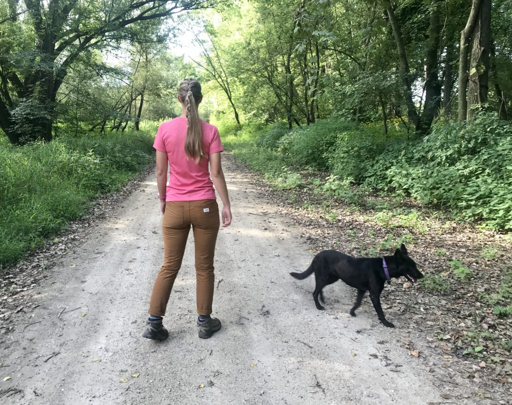 Annie and Luna hiking on a gravel path.