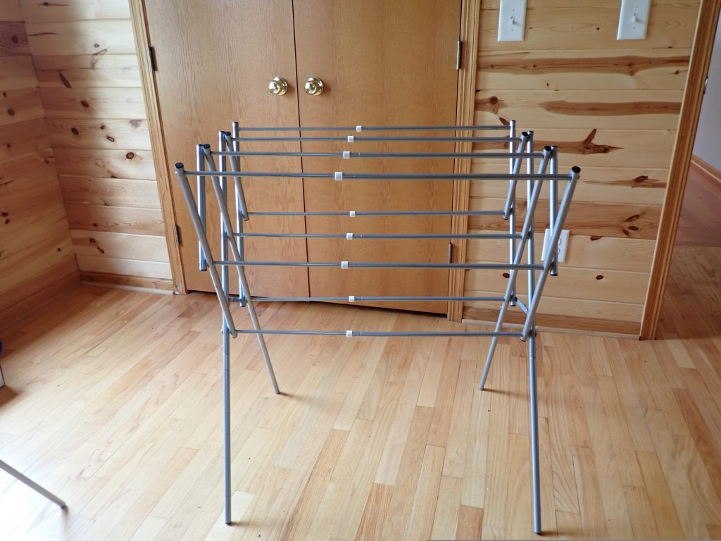 Clothing drying rack that is meant for indoor use. Caption states it's great for indoor drying in place of outside clotheslines!