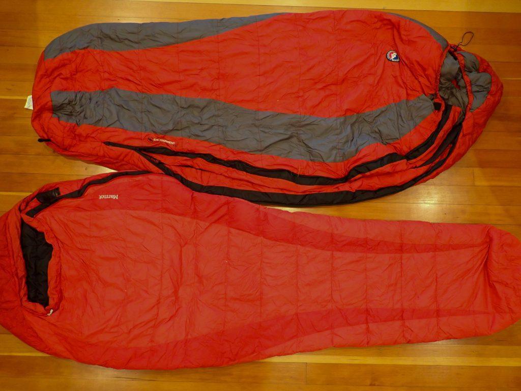 Two sleeping bags laying on hardwood floor.