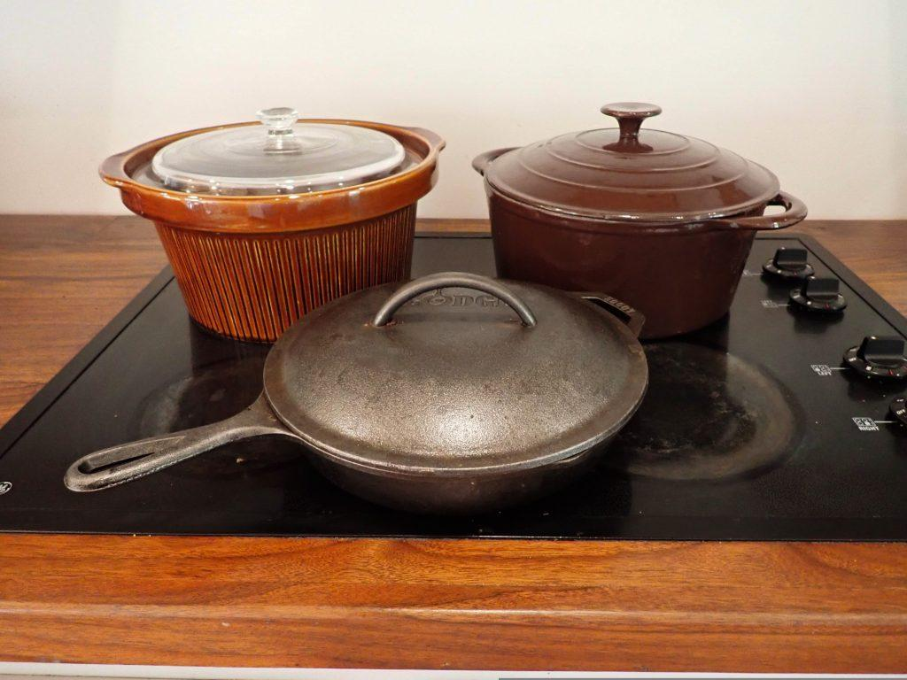 The main 3 items I use in my kitchen, a cast iron skillet, a dutch oven, and a crock pot.